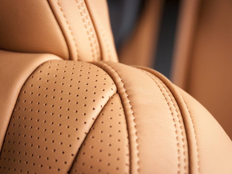 Modern sport car perforated red leather interior